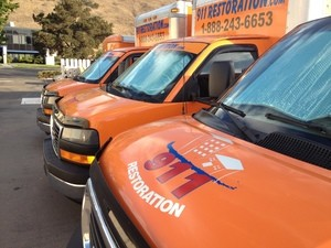 Water Damage Restoration Vans Parked