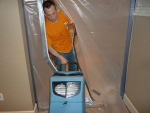 Water Damage Dixieland Technician Using Air Mover Near Vapor Barrier