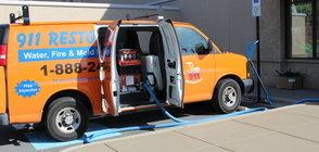 Water Damage Herber Restoration Van At Exterior Of Job Location