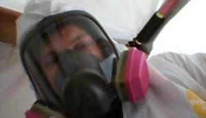 Mold Damage Restoration Technician With Mask