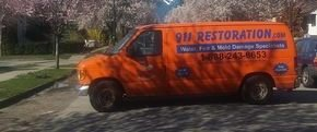 Water Damage Restoration Van At Residential Job Site