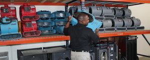 Mold Damage Restoration Technician Mobilizing Air Movers