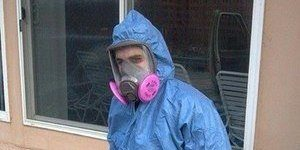 Water Damage Restoration Technician Suited Up